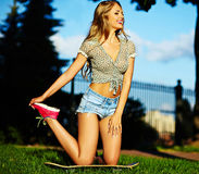 Stylish smiling girl in bright casual cloth in jeans shorts outdoors Stock Images