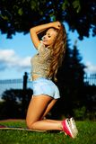 Stylish smiling girl in bright casual cloth in jeans shorts outdoors Royalty Free Stock Photos