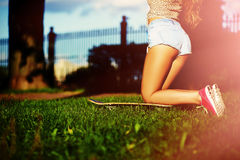Stylish smiling girl in bright casual cloth in jeans shorts outdoors Royalty Free Stock Photography
