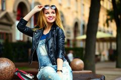 Stylish smiling girl in casual cloth in the city park Stock Photo