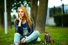 Stylish smiling girl in casual cloth in the city park Royalty Free Stock Photography