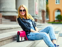 Stylish smiling girl in casual cloth in the city park Stock Photography