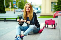 Stylish smiling girl in casual cloth in the city park Royalty Free Stock Images