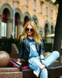 Stylish smiling girl in casual cloth in the city park Royalty Free Stock Photo