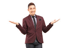 Stylish smiling male gesturing with hands Royalty Free Stock Photography
