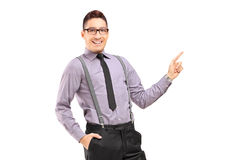 Stylish smiling male pointing Royalty Free Stock Images
