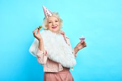 Stylish smiling woman in trendy clothes having fun on her Birthday stock photography