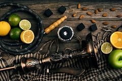 Stylish Smoking hookah and basket with lemon, lime and orange on. Wooden background. Top view. Flat lay. Copy space. Still life stock images