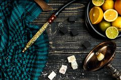 Stylish Smoking hookah and basket with lemon, lime and orange on. Wooden background. Top view. Flat lay. Copy space. Still life stock photos