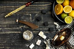 Stylish Smoking hookah and basket with lemon, lime and orange on. Wooden background. Top view. Flat lay. Copy space. Still life stock photography