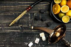 Stylish Smoking hookah and basket with lemon, lime and orange on. Wooden background. Top view. Flat lay. Copy space. Still life royalty free stock photography