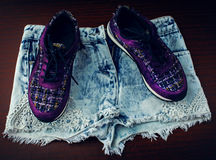 Stylish sneakers and denim shorts Royalty Free Stock Images