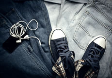 Stylish sneakers and gadgets. Stylish denim sneakers and gadgets Stock Photo