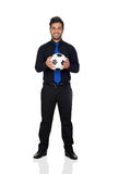 Stylish soccer player with a ball Stock Photos