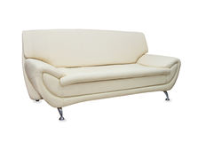 Stylish sofa from beige leather isolated over white Royalty Free Stock Image
