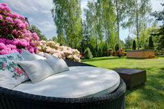 Stylish sofa in the garden Stock Photos