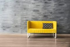 Stylish sofa near wall Royalty Free Stock Photo