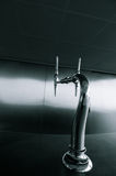 Stylish spigot in modern bar environment Royalty Free Stock Images