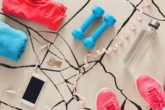 Stylish sport clothing and equipment top view. Copy space. Set of new bright fitness outfit, active lifestyle, body care concept Royalty Free Stock Photos