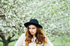 Stylish spring bohemian outfits. Wearing a white sweater and bla Royalty Free Stock Photos