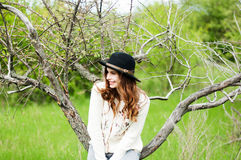Stylish spring bohemian outfits. Wearing a white sweater and bla Royalty Free Stock Photo