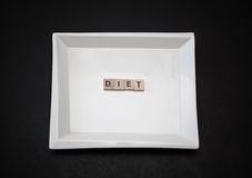 stylish square ceramic plate with word diet made of wooden small squares Stock Photo