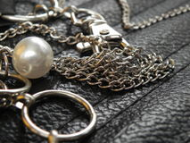 Stylish steel chain belt and pearl Stock Photography