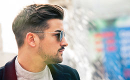 Stylish straight hair. Man profile with sunglasses. A handsome young man wearing sunglasses. Close portrait with face in profile. Space on the right for Stock Photo
