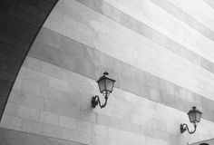 Stylish street lamps on wall. Royalty Free Stock Photography