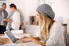 Stylish student girl working on laptop Stock Image