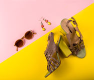 Stylish summer fashion essentials. On a pink and yellow backgroun Stock Photo
