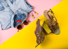 Stylish summer fashion essentials. On a pink and yellow background Stock Image