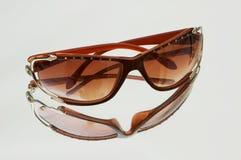 Stylish sun glasses. On highly reflective background Stock Photography