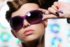 Stylish sunglasses on the beautiful female face Royalty Free Stock Photography