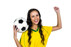 Stylish supporting woman holding football ball rejoicing Royalty Free Stock Photo