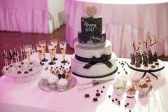 Stylish sweet candy bar set at the wedding ceremony. Confectionery stock photo