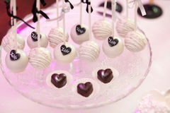 Stylish sweet candy bar set at the wedding ceremony, hearts. Confectionery. Selective focus stock photography