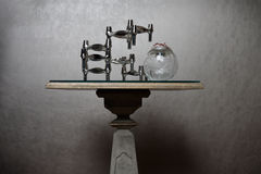 Stylish table with abstract sculpture Royalty Free Stock Photos