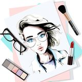 Stylish table set with hand drawn woman portrait, papers, lipstick, eyeglasses, brush and eyeshadows. Sketch. Vector illustration Royalty Free Stock Photo