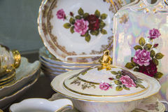 Stylish tableware with painted roses Royalty Free Stock Photos