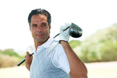 Stylish and a talented golfer Stock Images