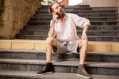 Stylish tattoed and bearded guy posing outdoor Royalty Free Stock Photos
