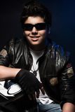Stylish teen boy biker Royalty Free Stock Image