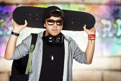 Stylish teen boy with skateboard Stock Photography