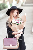 Stylish teen girl with flowers Royalty Free Stock Photo