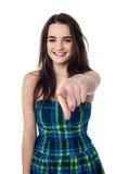 Stylish teen girl indicating forward Stock Images