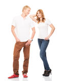 Stylish teenage couple standing isolated on white Royalty Free Stock Photography