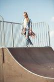 Stylish teenage girl at skateboard park royalty free stock images