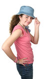 Stylish Teenaged Model. A stylish teenaged girl wearing jeans and a hat isolated Royalty Free Stock Images