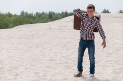 Stylish teenager on the beach. Stylish teen with suitcase on the beach Stock Photography